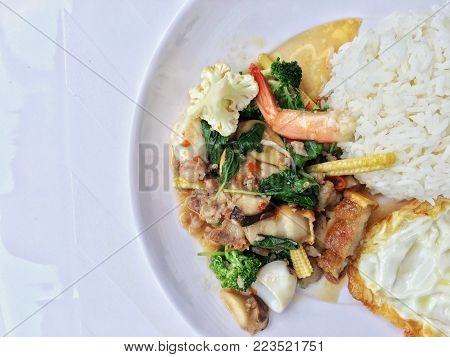 Stir Fried Crispy Pork, Shrimp, Mix Seafood With Thai Holy Basil, Chilies, Garlic, And Soy Sauce. In