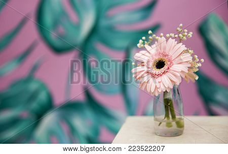Pebbles background against beautiful spring pink flower. Spa zone
