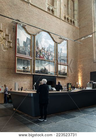 ALKMAAR,  NETHERLANDS - APRIL 21, 2017: people in the cafe inside the Church of St. Lawrence (Grote Kerk or Great Church) in Alkmaar, Netherlands.