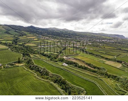 Aerial view of fields and houses near the small village of Ginetes on Azorean island of Sao Miguel in Portugal.