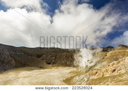 Clouds begin to form over the active crater of Mount Egon on Flores Island in Indonesia.