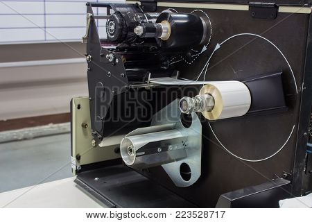 The inside of old label printing machine