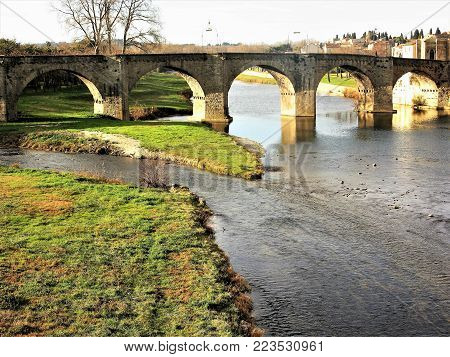 View of the old arched bridge over the River Aude at Carcassonne, France