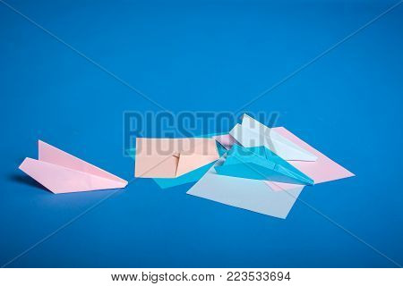 Place for making origami paper planes. Blue, blue, pink origami airplanes crafts.