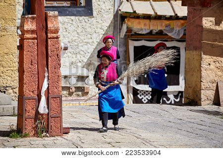 Shangri-La, China - September 25, 2017: Women clean up the Songzanlin Monastery, built in 1679, is the largest Tibetan Buddhist monastery in Yunnan province, known as Little Potala Palace.