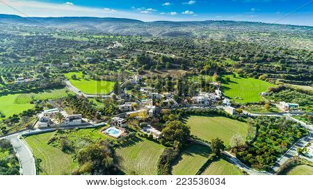 Aerial bird's eye view of traditional village Kato Akourdalia, Paphos, Cyprus. The mountains, valley, trees, nature, Latchi - Akamas beach and agritourism resorts and villas in Pafos from above.