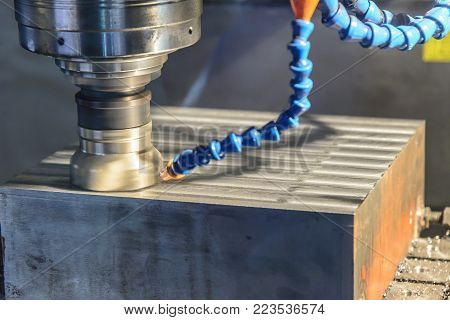The CNC milling machine cutting cutting the raw material with the small ball-end mill tool .Hi-precision CNC machining concept.