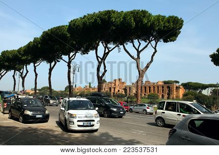 ROMA, ITALY, APRIL 7, 2016 : Street of Rome. On the background  Circus Maximus and ruins of Palatine hill, in Rome, Italy.  Every year more than 40 million tourists . Every year more than 40 million tourists .