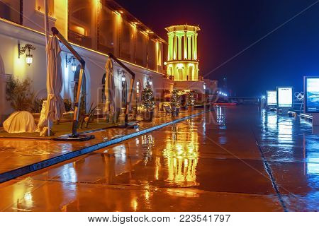 SOCHI, RUSSIA - JANUARY 11, 2018: Sea port embankment at night illumination