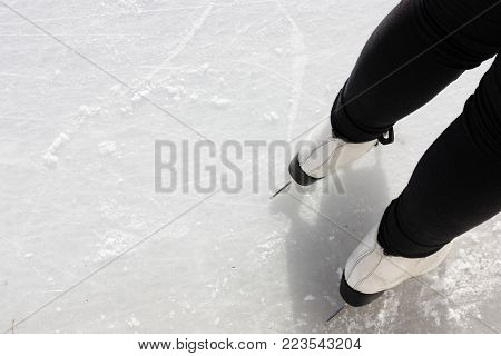 person in skates on skating ice rink