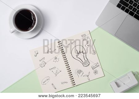 Business ideas, creativity, inspiration and start up concepts, ideas message on notebook with lightbulb.