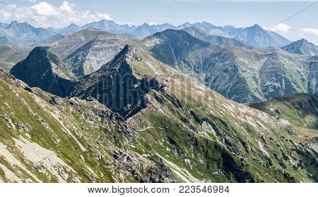 Tatra mountains panorama with many peaks of Western and High Tatras  from Banikov peak on Rohace mountain group in Western Tatras mountains in Slovakia