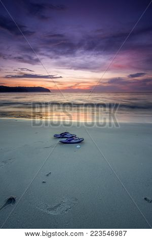 Beautiful view of sunset at Langkawi Island,Malaysia. soft focus, blur due to long exposure. Visible noise due to high ISO.