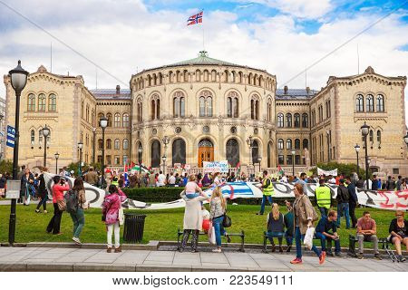 Oslo, Norway-August 13, 2014 -Solidarity activists hold a banner reading