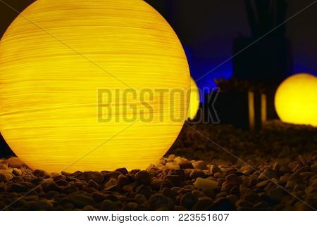 Ball shape lamps on stones. Peaceful horizontal image.