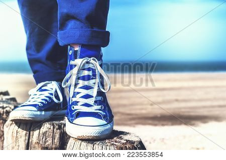Summer seascape with relaxing teenager. Nature and vacation background
