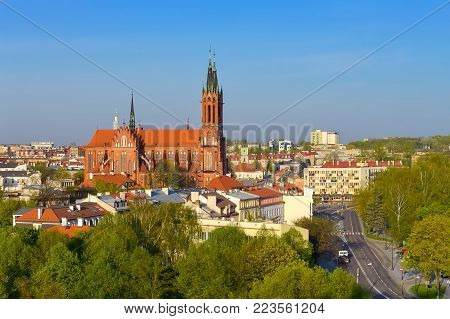 Cathedral Basilica of Assumption of Blessed Virgin Mary in Bialystok, Poland. Gothic architecture of red brick - religious memorial and place of worship. Early morning sunrise