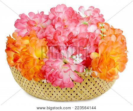 Top view of basket beautiful large bouquet of Artificial flowers rose peony red white yellow and orange bright color made of synthetic fabric and plastic. Items pictured close up isolated on white background.
