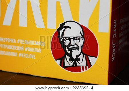MOSCOW, RUSSIA - JANUARY 11, 2018: KFC (Kentucky Fried Chicken) Fast Food Meal Box with Colonel Sanders Brand Logo. KFC is an American Fast Food Restaurant Chain Specialized in Fried Chicken.