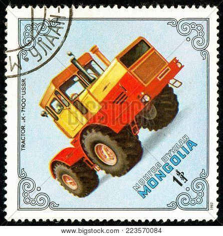 Ukraine - circa 2018: A postage stamp printed in Mongolia show Tractor K-7100, USSR. Series: Tractors. Circa 1982