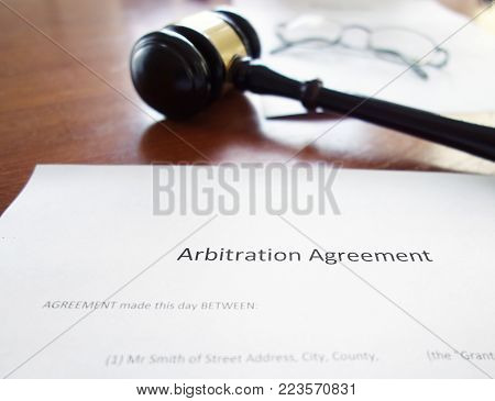 An arbitration agreement contract with court gavel