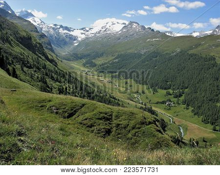 Beautiful river valley in the Upper Engadine region of Switzerland backed by snow covered mountains