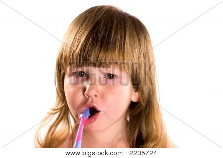 Child Cleaning Her Teeth
