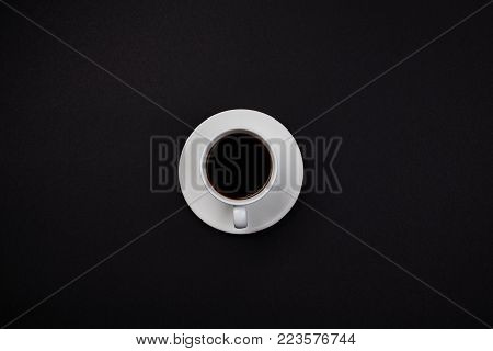Cup of coffee. An invigorating drink. Hot. Delicious. For your design. View from above.