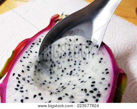 Dragon fruit and dragon fruit slice in white dish on table,Eating fresh dragon fruit
