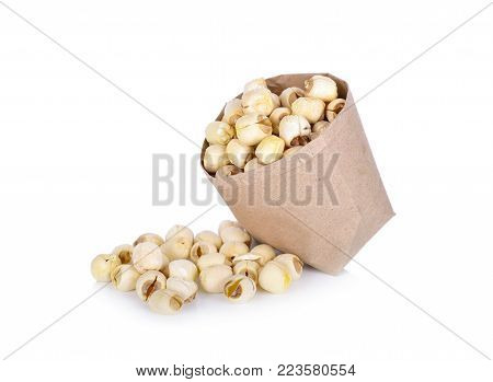 dried lotus seeds in paper bag and on white background