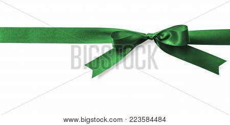 Green satin bow ribbon emerald kelly jade Christmas color stripe fabric bow isolated on white background with clipping path