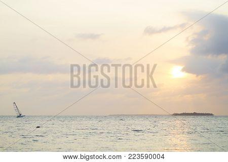 Happy Man Sailing Catamaran