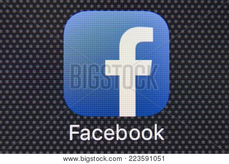 Sankt-Petersburg, Russia, January 25, 2018: Facebook application icon on Apple iPhone 8 smartphone screen close-up. Facebook app icon. Facebook is the biggest internet online social network