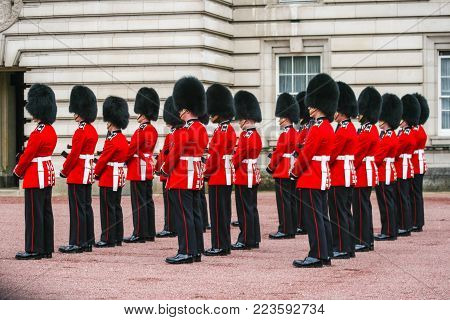 LONDON, ENGLAND - MAY 10, 2012 : British Guards in a famous red uniforms are in rows during the Changing Guard Ceremony takes place in Buckingham Palace
