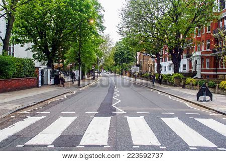LONDON, ENGLAND - MAY 10, 2012 : The famous scenery of zebra crossing at Abbey Road made famous by the 1969 Beatles album cover