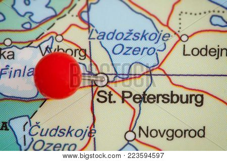 Close-up of a red pushpin on a map of St. Petersburg, Russia.