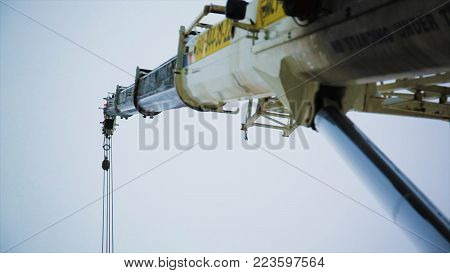 Construction of a high-rise building with a crane. Building construction using formwork. The construction crane.