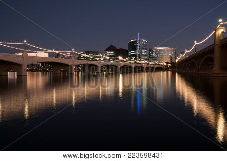 TEMPE, AZ - OCTOBER 25, 2017: The city skyline of Tempe, Arizona at night from across the Salt River at Tempe Town Lake