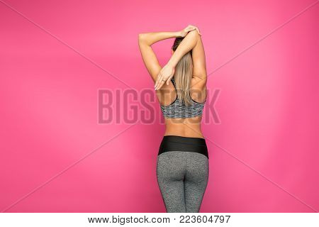 Athletic Woman On Pink Background