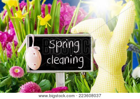 Sign With English Text Spring Cleaning. Sunny Spring Flowers Like Daisy And Narcissus. Easter Decoration Like Egg And Bunny.