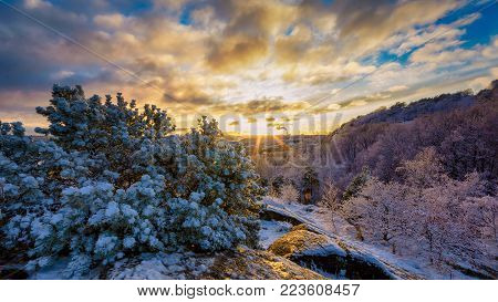 Snow filled mountain and setting sun, Gothenburg, Sweden December 2017.