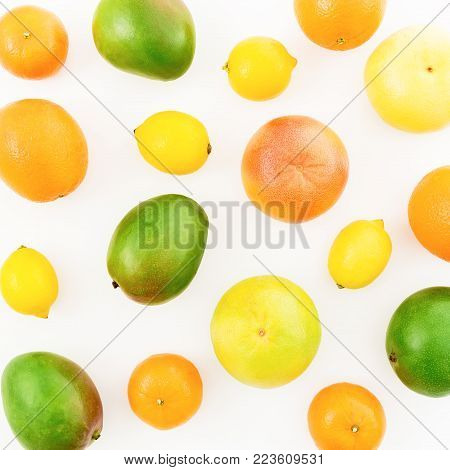 Lemon, orange, grapefruit, sweetie and mangos on white background. Flat lay, top view. Food background