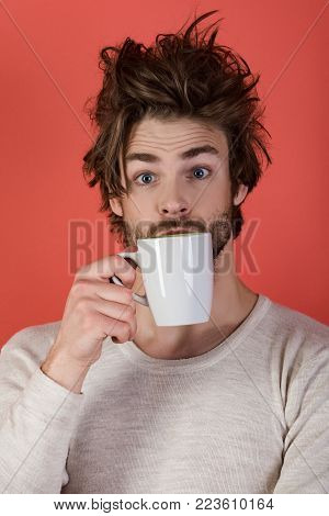 Surprised Guy With Tea Cup On Red Background.