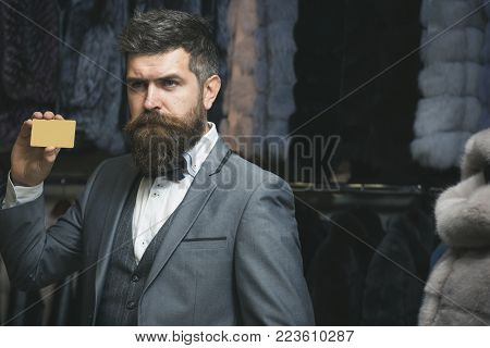 Purchase, shopping, business, moneybags. bearded man among fur, luxury, moneybags, business. Fashion and beauty, winter, fur. Shopping, customer with card. Valentines day, man buy present, shopaholic.