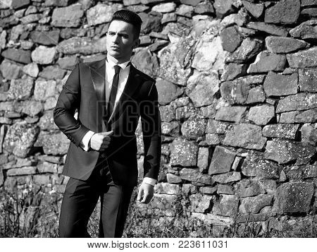 Man Young Handsome Elegant Model Wears Suit White Shirt With Black Skinny Necktie Looks Into Distanc