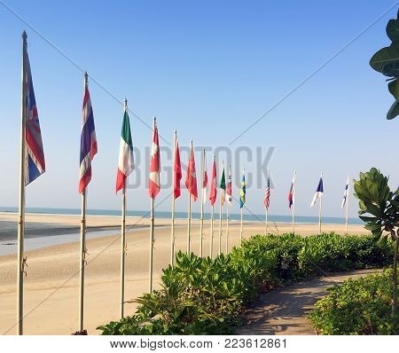 Sandy Beach And Flags Of The Different Countries On The Seashore. Thailand