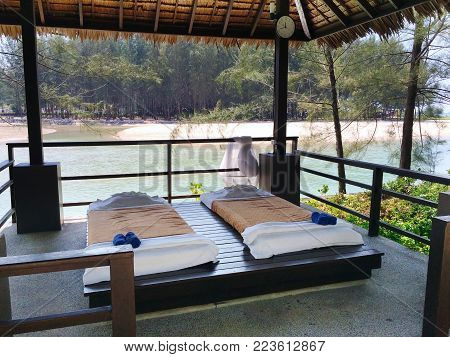 The Massage Pavilion With Beds For Rest On The Sandy Beach. Thailand