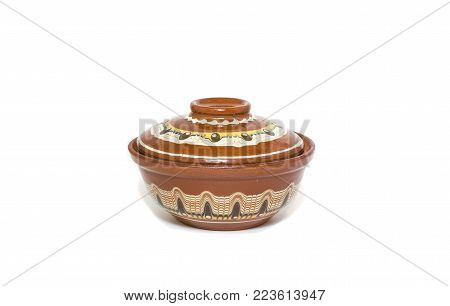 Decorated clay bowl isolated on white background.