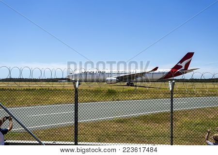 BRISBANE - January 19, 2018: People watching Qantas Airways A330-303 taxiing for take off at Brisbane Airport, Australia