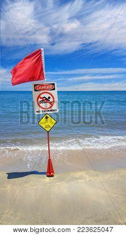 Danger Red Flag sign Do Not Swim as stingers on beaches
